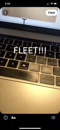 Twitter Fleets edit screen with text in blue saying Fleet over an image of a laptop keyboard