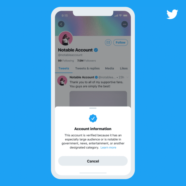 Phone screen featuring Twitter account with blue verification badge